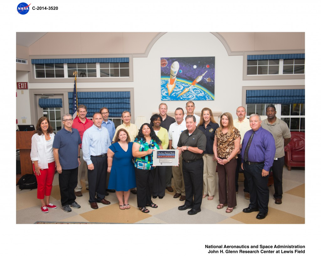 Members of the CIO's office celebrated NASA's Best Place to Work achievement during their 2014 CIO Leadership Meeting.  Those present to showcase the plaque included Leigh Anne Girardi, Jim Rinaldi, Larry Freudinger, Sean Gallagher, Dana Mellerio, Lara Petze, Dennis Vandertuig, Dinna Cottrell, Annette Moore, Jeff Seaton, Gary Cox, Larry Sweet, Jonathan Pettus, Deborah Diaz, Vanessa Stromer, Terry Jackson, Jim Walker and Victor Thompson.