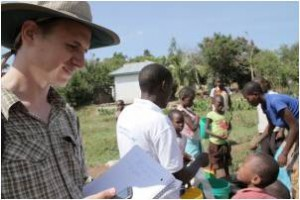 John Feighery helping to check water in Tanzania. (Credit: Annie Feighery)