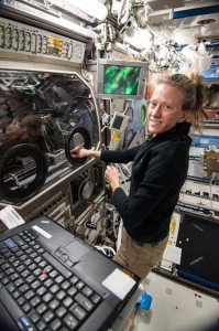 "One of our ""people in space,"" NASA astronaut Karen Nyberg works with the InSPACE-3 colloid investigation in the Microgravity Science Glovebox. (NASA)"