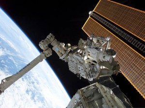The International Space Station Canadarm (pictured here) led to a technology spinoff to assist with brain surgery on Earth. (NASA)
