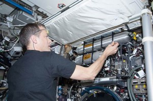 NASA astronaut Tom Marshburn servicing the Combustion Integrated Rack (CIR) aboard the Destiny module of the International Space Station. (NASA)