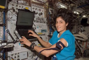 Astronaut Sunita Williams, Expedition 14 flight engineer, prepares a laptop for data entry during a blood draw as part of the Nutritional Status Assessment (Nutrition) study in the Destiny laboratory module of the International Space Station. (NASA)