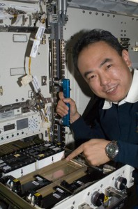 View of Expedition 28 Flight Engineer Satoshi Furukawa with the JAXA Protein Crystal Growth (PCG) investigation aboard the International Space Station Japanese Experiment Module (JEM). (NASA)