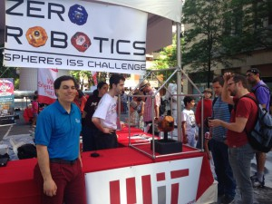 At left, Alvar Saenz-Otero, Ph.D., and his team present the Zero Robotics: International Space Station Programing Challenge to the public at the World Science Festival in New York. (Tara Ruttley)