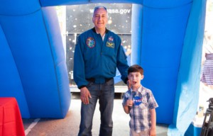 NASA astronaut Mike Massimino meets a young fan at the 2014 World Science Festival. (World Science Festival)