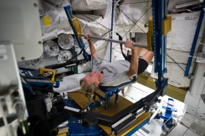 Expedition 36 Flight Engineer Karen Nyberg of NASA gets a workout on the Advanced Resistive Exercise Device (ARED) in the Tranquility node of the International Space Station. (NASA)