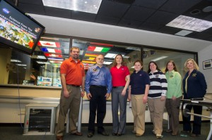 Image from the Payload Operations Integration Center's 12th anniversary, from left, Kevin Barnes, payload rack officer; Rick Rodriguez, Stephanie Buskirk Dudley and Katie Presson, all payload operations directors; Penny Pettigrew, payload communications manager; Carol Jacobs, payload operations director; and Ola Myszka, operations controller. (NASA/Emmett Given)