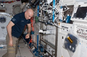 Astronaut Luca Parmitano getting ready to activate specific SSEP mini-labs aboard the International Space Station. The SSEP Falcon I Experiment Payload box is open. (NASA)