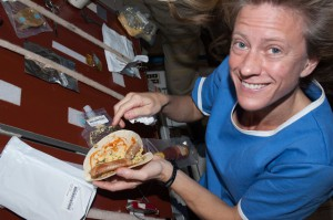 NASA astronaut Karen Nyberg, Expedition 36 flight engineer, prepares a breakfast taco using a tortilla. Foods like this tortilla are traditionally fortified with iron, which may account for some of the increase of the mineral during the early days of spaceflight in astronauts. (NASA)