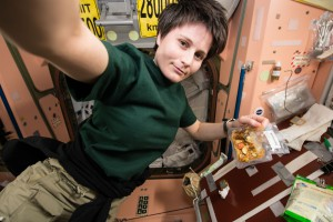 Studies regarding nutrition aboard the International Space Station can lead to benefits for future explorers, as well as those with health concerns on Earth. Here ESA astronaut Samantha Cristoforetti, Expedition 41, enjoys a prepackaged meal while living in space. (NASA)