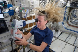 NASA astronaut Karen Nyberg, Expedition 36 flight engineer, conducts an ocular health exam on herself in the Destiny laboratory of the Earth-orbiting International Space Station. (NASA)