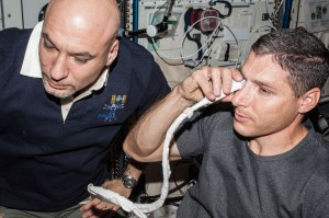 NASA astronaut Michael Hopkins and European Space Agency astronaut Luca Parmitano perform ultrasound eye imaging as part of the Fluid Shifts investigation during Expedition 37 on the International Space Station. (NASA)