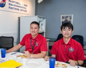International Space Station Expedition 44/45 crew members Kjell Lindgren and Kimiya Yui enjoying food tasting at NASA's Habitability and Environmental Factors Office in Houston. Lindgren plans to take his own espresso grounds with him into orbit to enjoy as part of the Capillary Beverage study. (NASA/Bill Stafford)