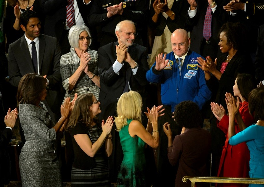 NASA astronaut Scott Kelly stands as he is recognized by President Barack Obama, while First Lady Michelle Obama (lower left corner) and other guests applaud. The President recognized Kelly during the State of the Union address on Capitol Hill in Washington D.C. on Jan. 20, 2015. (NASA/Bill Ingalls)
