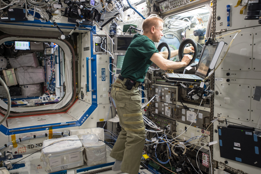 NASA astronaut Tim Kopra performs BASS-M operations in the Microgravity Sciences Glovebox in the Destiny Lab aboard the International Space Station.