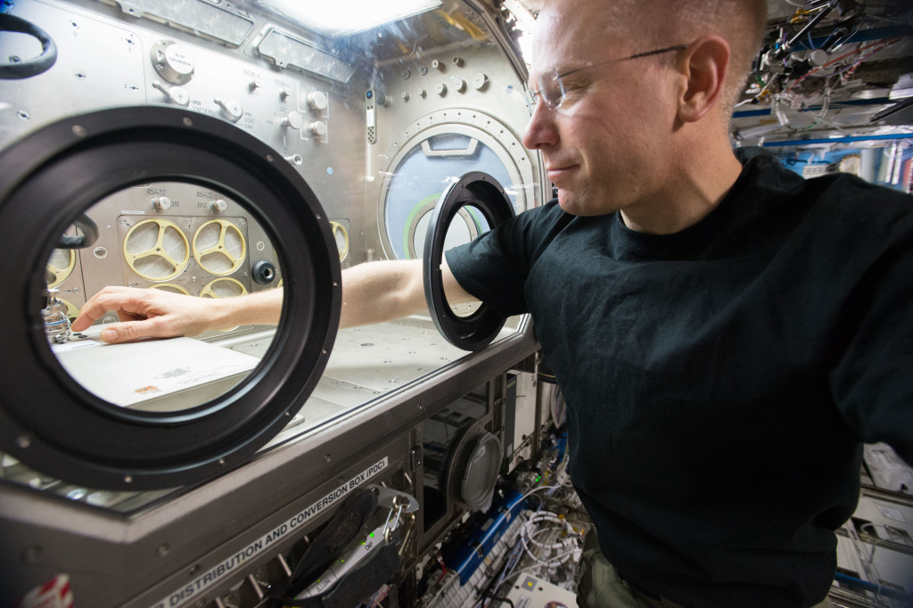 NASA astronaut Tim Kopra installed the Thermal Exchange hardware in the Microgravity Science Glovebox. Credits: NASA