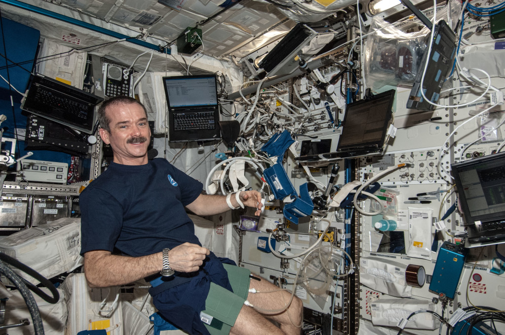 In support of the Blood Pressure Regulation Experiment (BP Reg), Expedition 35 Commander Chris Hadfield of the Canadian Space Agency is pictured after having set up the Human Research Facility (HRF) PFS (Pulmonary Function System) and the European Physiology Module (EPM) Cardiolab (CDL) Leg/Arm Cuff System (LACS) and conducting the first ever session of this experiment. Credits: NASA