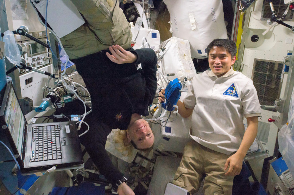NASA astronaut Kate Rubins (L) and JAXA astronaut Takuya Onishi participated in the ESA Airway Monitoring investigation last week. Credits: NASA