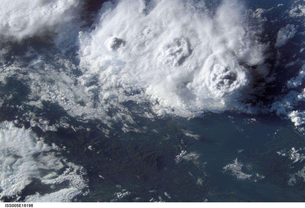From low earth orbit, astronauts have a unique perspective from which to view weather phenomena such as the cloud tops of thunderstorm cells. Cumulonimbus clouds tops (top half of image) were forming over the Gulf of Nicoya along the Pacific coastline of Costa Rica when the image was taken. This image was captured on Oct. 23, 2002. Credits: NASA