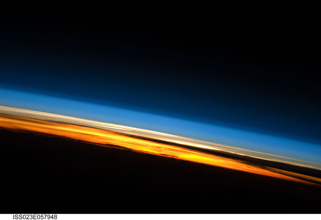 This spectacular image of sunset on the Indian Ocean was taken by astronauts aboard the International Space Station (ISS). The image presents an edge-on, or limb view, of the Earth's atmosphere as seen from orbit. The Earth's curvature is visible along the horizon line, or limb, that extends across the image from center left to lower right. This image was captured during Sellers' last mission to space, aboard STS-132. Credits: NASA