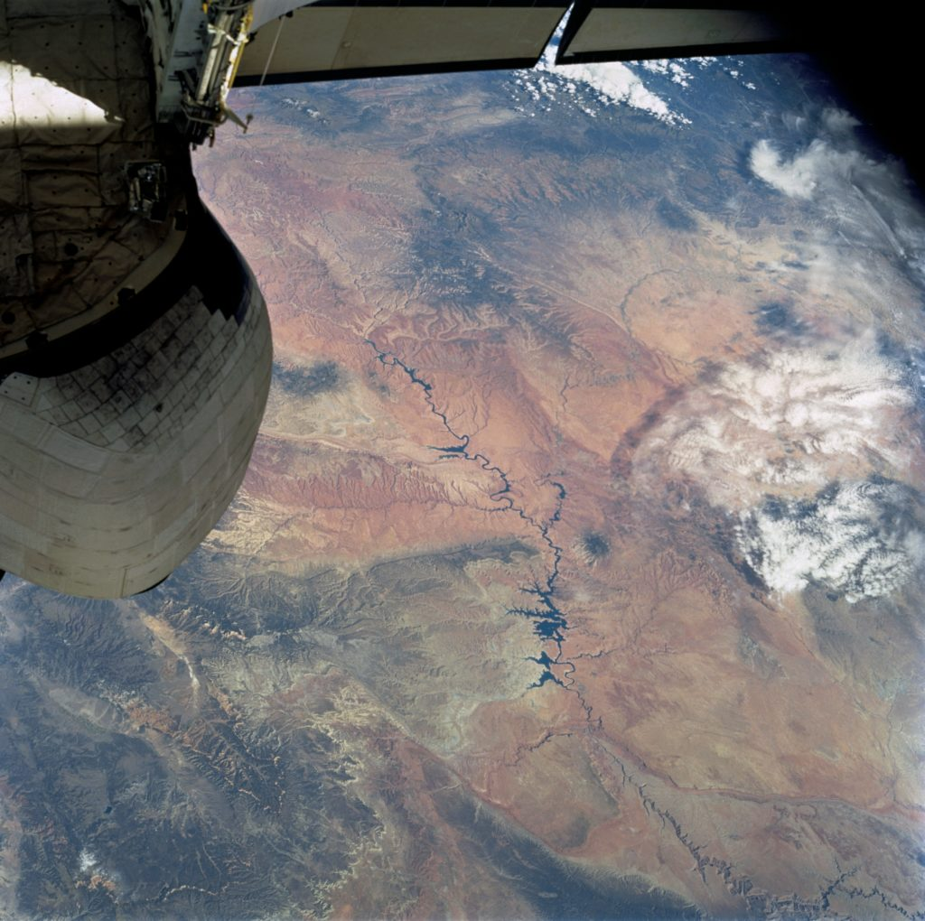 The Colorado River snakes across this view from top left (near the Space Shuttle stabilizer), to the lower right, where the Grand Canyon gorge can be detected. This image was captured on Oct. 13, 2002, during Sellers' mission aboard STS-112. Credits: NASA