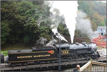 Steam locomotive blowing out steam through a relief valve.  Credit: Scott Schroeder