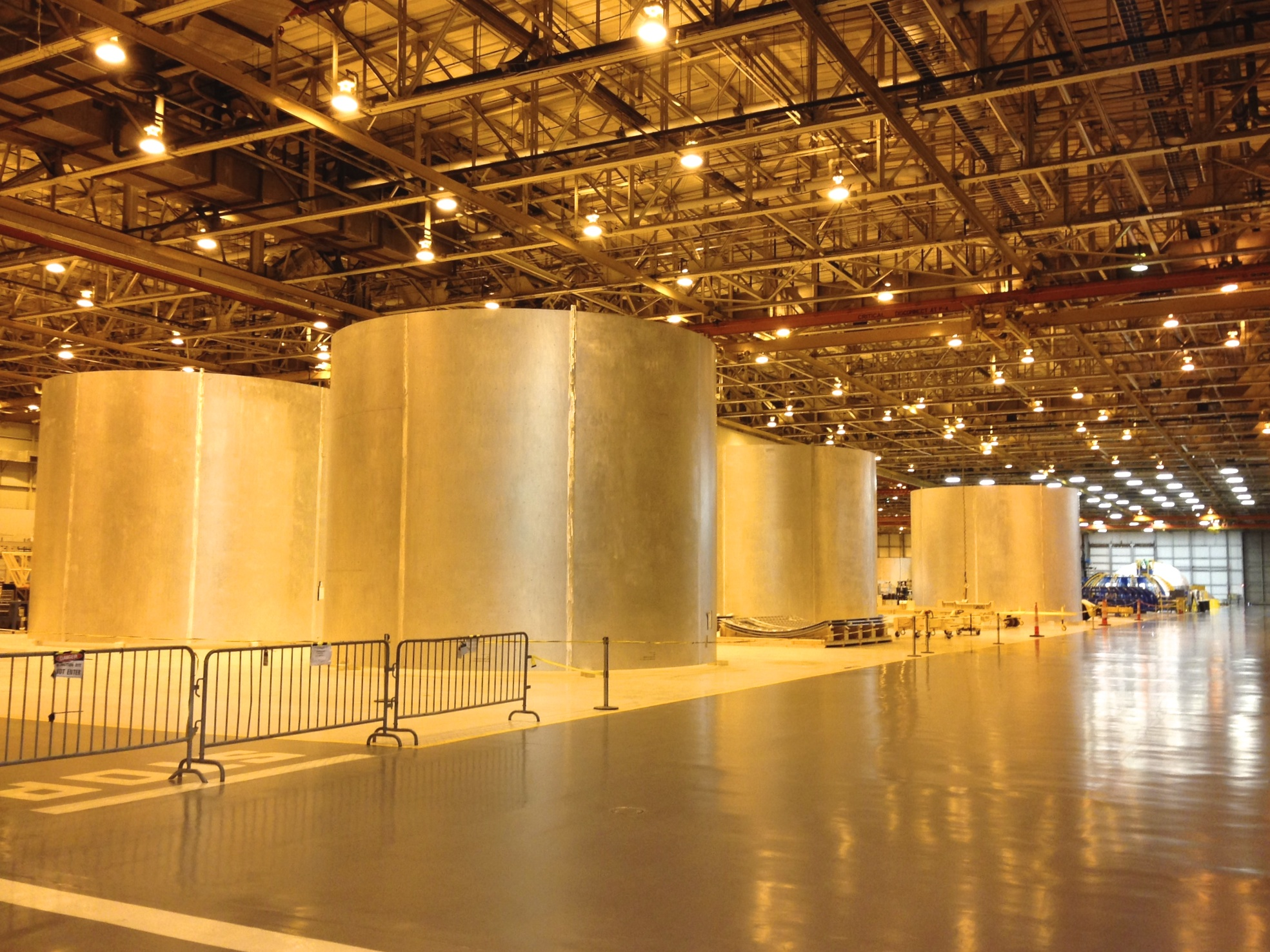 Four SLS barrel sections in a large room at Michoud Assembly Facility