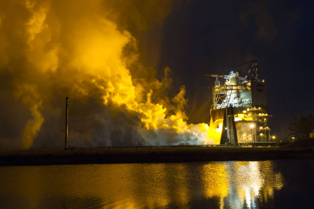 Fire streaming from a test stand during an RS-25 test