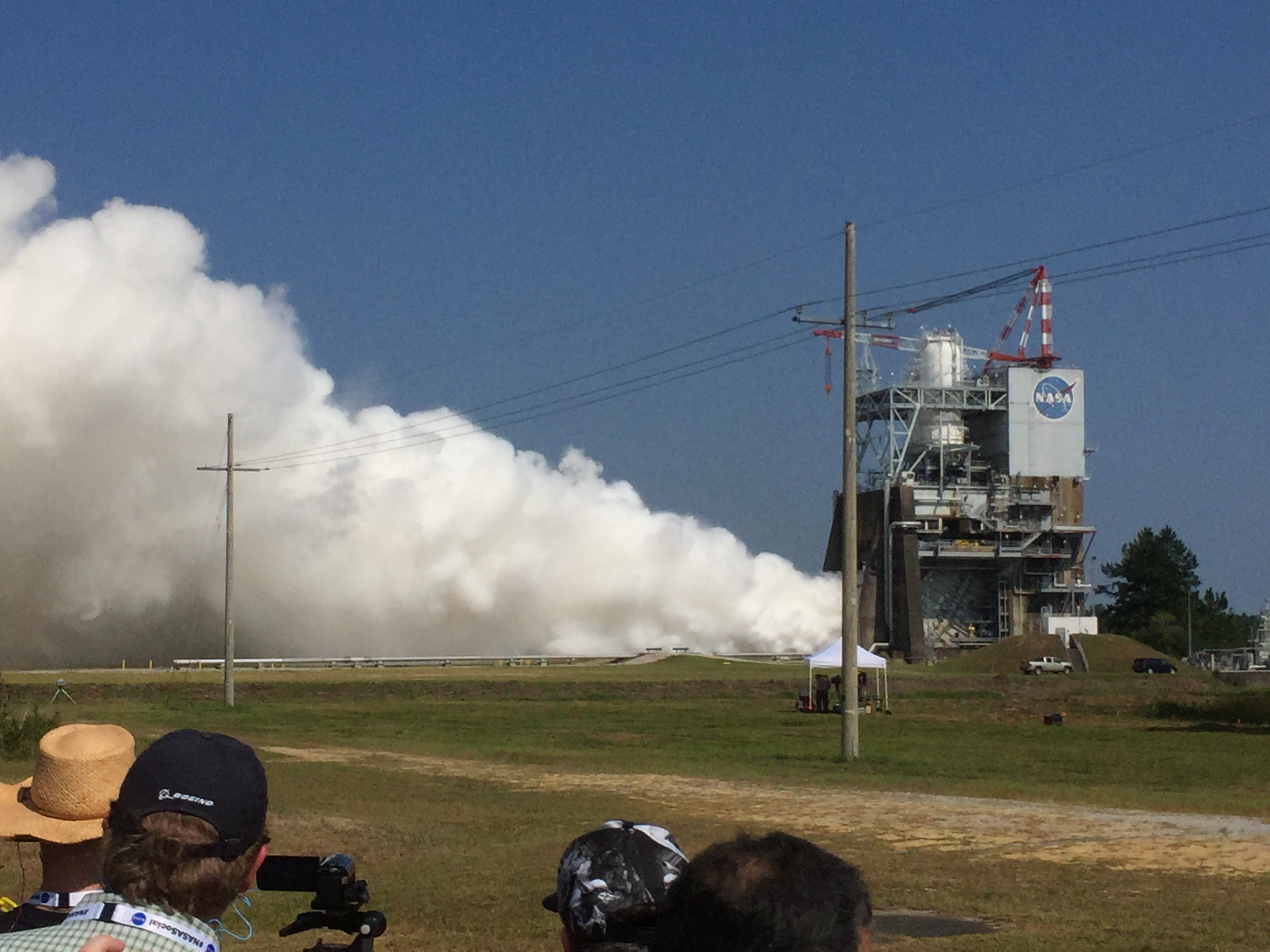 A white cloud emerges from the A-1 engine test stand