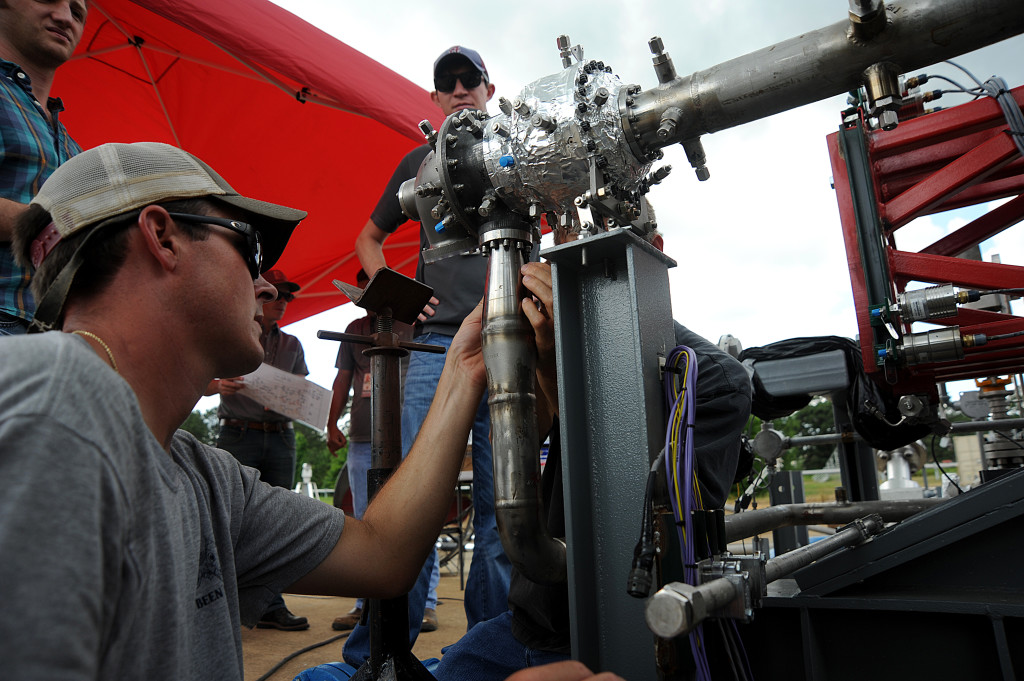 Engineers prepare a 3-D printed turbopump for a test at NASA's Marshall Space Flight Center in Huntsville, Alabama
