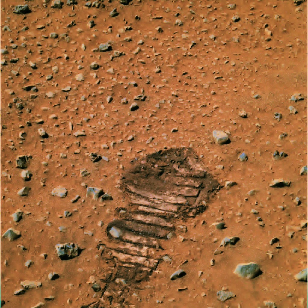 A photo of a rover wheel track on Mars that resembles a human footprint