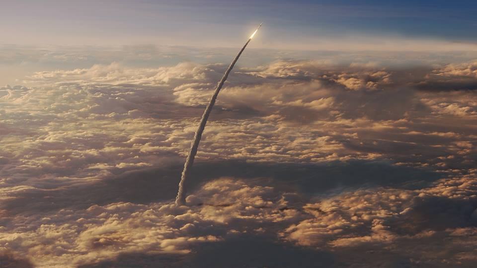 Artist's concept of SLS flying through clouds