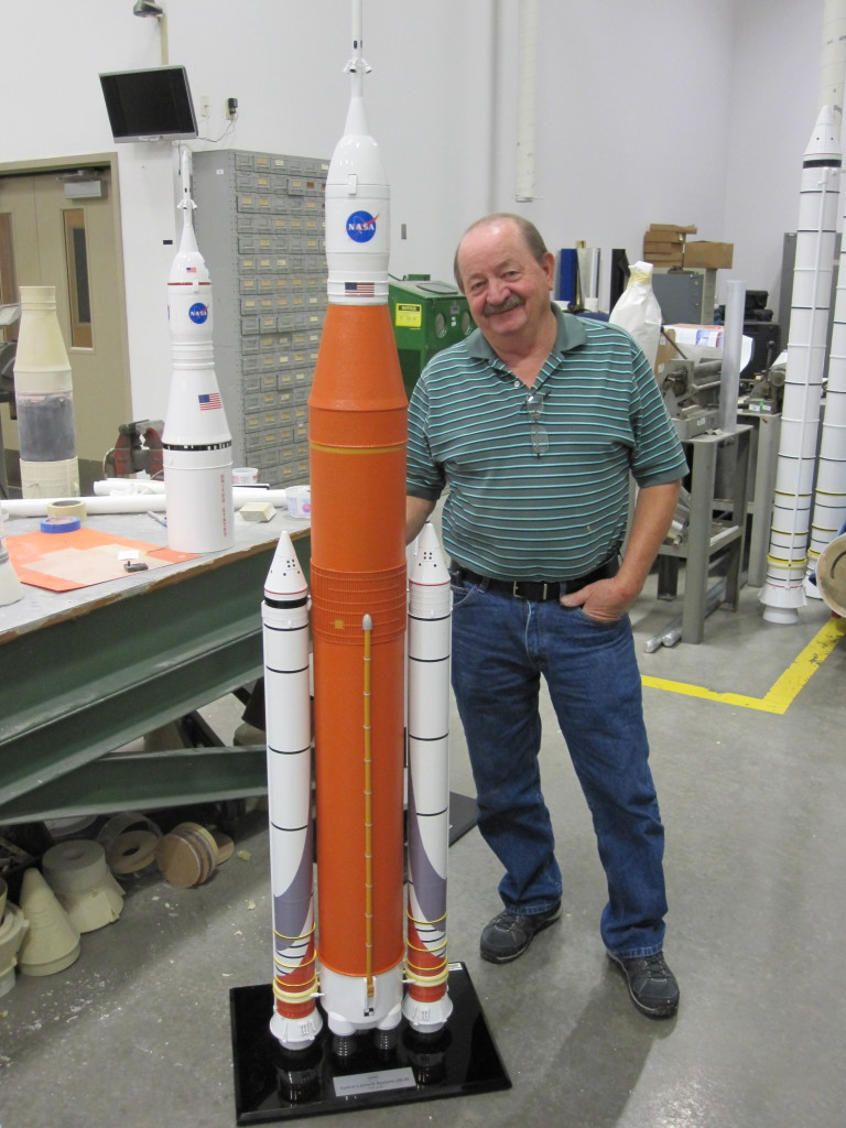 Barry Howell with a freshly updated 1-to-50 scale model of SLS