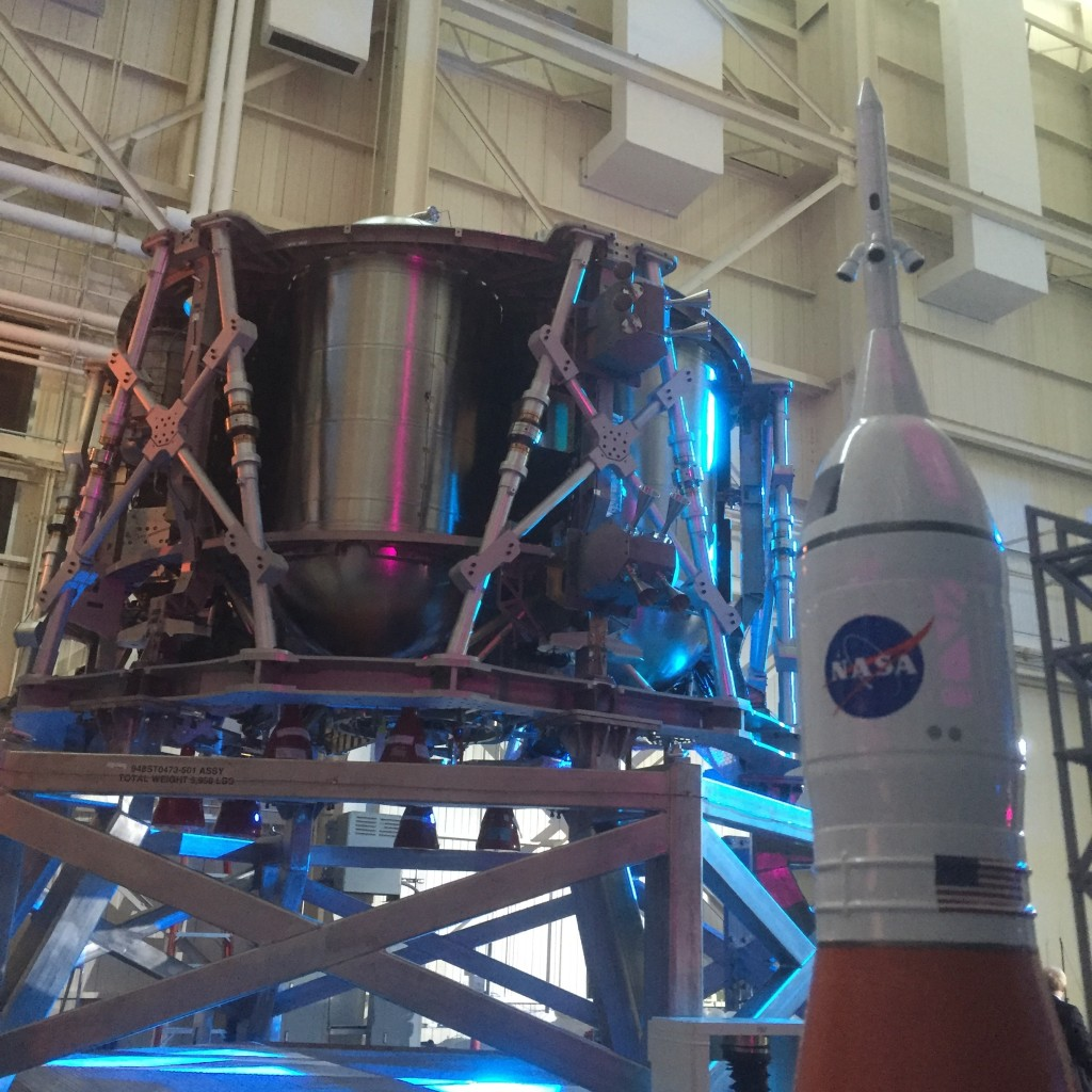 The Orion service module test article with a model of SLS