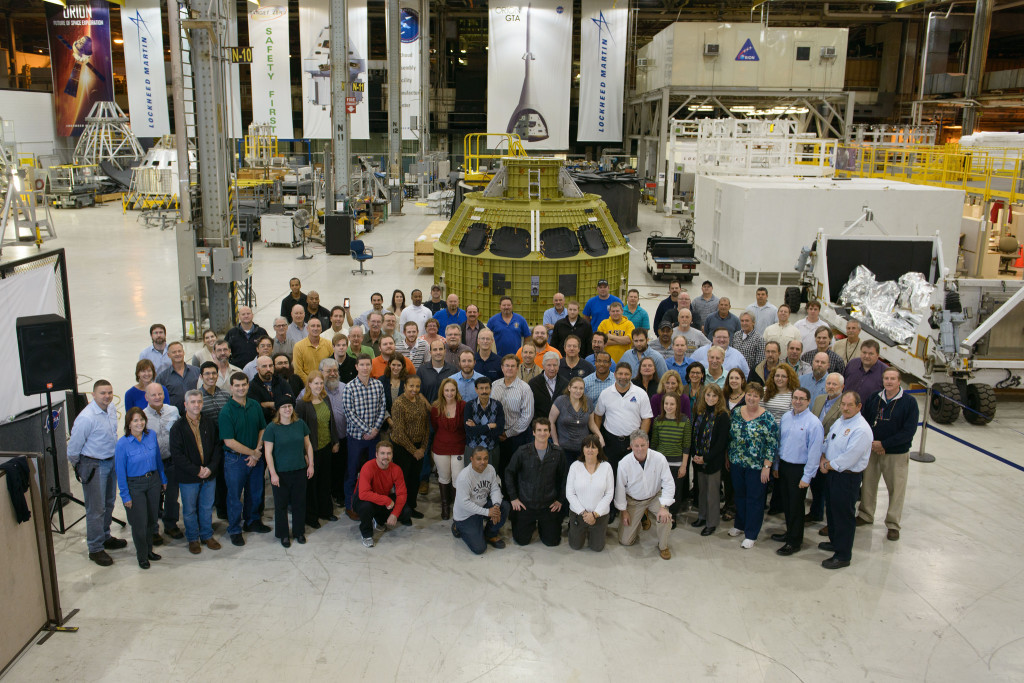The Orion team at the Michoud Assembly Facility poses with the Exploration Mission 1 crew module pressure vessel