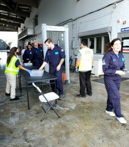 Marshall's flight team completes a TSA check before boarding G Force One.