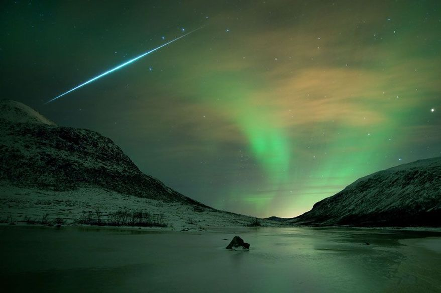 Nature's 'light show' is how NASA describes the Geminid meteor shower - a meteor flash is seen here with an aurora borealis shimmer in Norway