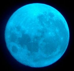 One way to make a Blue Moon is by using a blue filter. That's what a photographer did back in 2004 when he photographed this Full Moon rising over Brighton, Massachusetts. Credit: Kostian Iftica