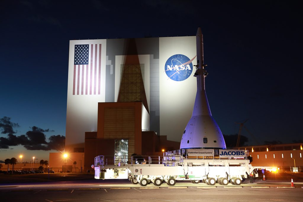 The flight test article for Orion's Ascent Abort-2 (AA-2) flight test passes by the Vehicle Assembly Building at NASA's Kennedy Space Center in Florida, on its 21.5-mile-trek to Space Launch Complex 46 at Cape Canaveral Air Force Station on May 22, 2019.