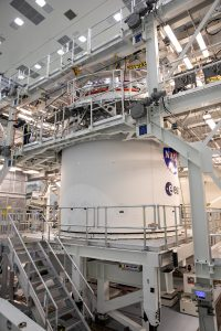 The NASA and ESA insignias are in view on the Orion spacecraft adapter jettison fairing inside the MPPF at Kennedy Space Center.