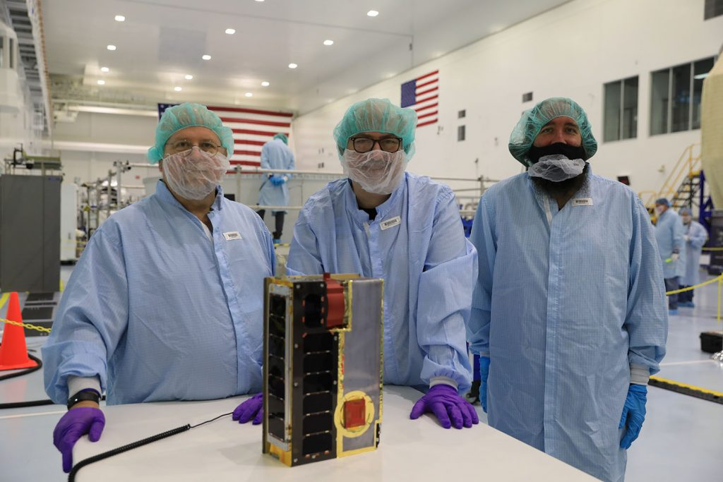 Team CuSP cheers on the solar CubeSat prior to loading it in the Space Launch System rocket Orion stage adapter at NASA's Kennedy Space Center in Florida.