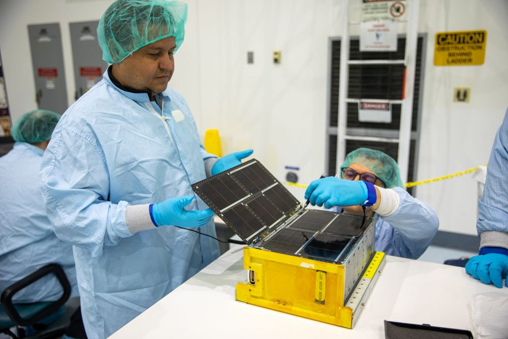 Team Miles works in a clean room at NASA's Kennedy Space Center