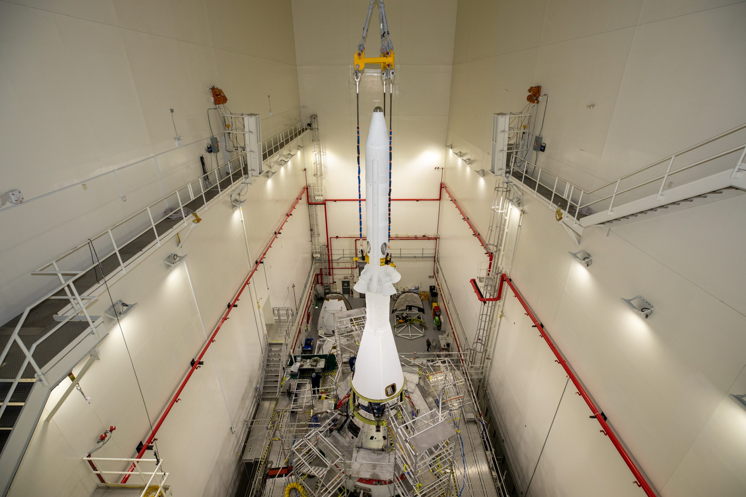 Teams with NASA's Exploration Ground Systems (EGS) and contractor Jacobs integrated the launch abort system (LAS) with the Orion spacecraft inside the Launch Abort System Facility at NASA's Kennedy Space Center in Florida on July 23, 2021.