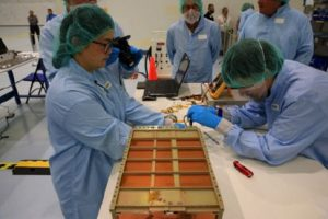The Near-Earth Asteroid Scout team prepares their secondary payload
