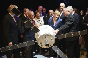 NASA Administrator Charles Bolden presents German Chancellor Angela Merkel with a model of the Orion crew vehicle at the Berlin Air Show. The European Space Agency is providing the spacecraft's service module. Photo credit: European Space Agency (ESA).