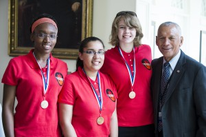 "NASA Administrator Charles Bolden poses with an all-girl engineering team that participated in the White House Science Fair. ""Team Rocket Power"" was one of 100 teams that qualified for last year's Team America Rocketry Challenge (TARC). Nia'mani Robinson, 15, Jasmyn Logan, 15, and Rebecca Chapin-Ridgely, 17, gave up their weekends and free time after school to build and test their bright purple rocket, which is designed to launch to an altitude of about 750 ft, and then return a ""payload"" (an egg) to the ground safely. The fourth White House Science Fair was held at the White House on May 27, 2014 and included 100 students from more than 30 different states who competed in science, technology, engineering, and math (STEM) competitions. (Photo Credit: NASA/Aubrey Gemignani)"