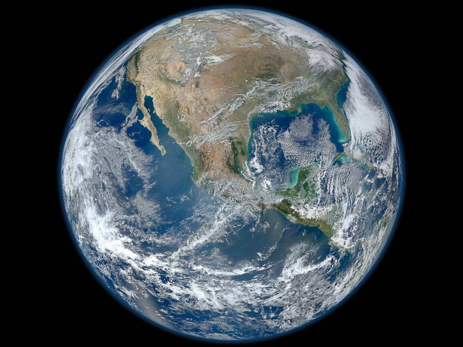 A 'Blue Marble' image of the Earth taken from the VIIRS instrument aboard NASA's most recently launched Earth-observing satellite - Suomi NPP. This composite image uses a number of swaths of the Earth's surface taken on January 4, 2012. The NPP satellite was renamed 'Suomi NPP' on January 24, 2012 to honor the late Verner E. Suomi of the University of Wisconsin.  Suomi NPP is NASA's next Earth-observing research satellite. It is the first of a new generation of satellites that will observe many facets of our changing Earth.  Suomi NPP is carrying five instruments on board. The biggest and most important instrument is The Visible/Infrared Imager Radiometer Suite or VIIRS.  Image Credit: NASA/NOAA/GSFC/Suomi NPP/VIIRS/Norman Kuring