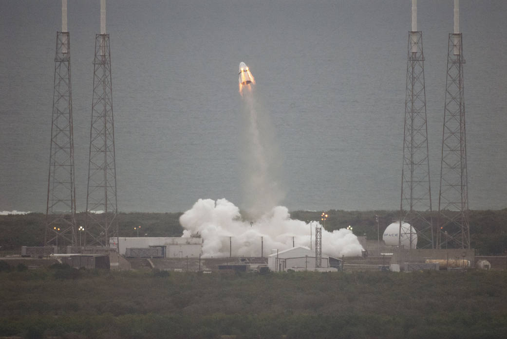 May 6, 2015 -- Eight SuperDraco engines boost a SpaceX Crew Dragon spacecraft away from Space Launch Complex 40 at Cape Canaveral Air Force Station in an emergency pad abort simulation. Each of the eight SuperDraco engine generates 15,000 pounds of thrust and burns about six seconds. The test began at 9 a.m. After the engines shut down, the Dragon spacecraft's trunk, with passive fins for stability, will separate when it reaches peak altitude. Photo credit: NASA