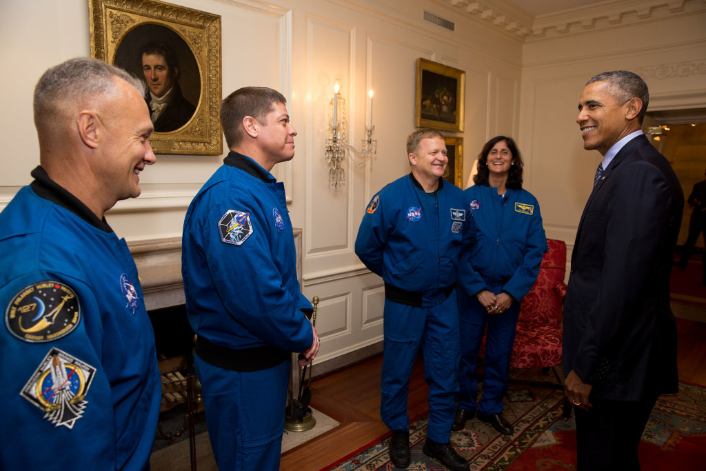President Barack Obama greets NASA Commercial Crew astronauts: Robert Behnken, Eric Boe, Douglas Hurley and Sunita Williams, NASA Administrator Charles Bolden, and NASA Deputy Administrator Dava Newman, in the Map Room before White House Astronomy Night on the South Lawn of the White House, Oct. 19, 2015. (Official White House Photo by Pete Souza)