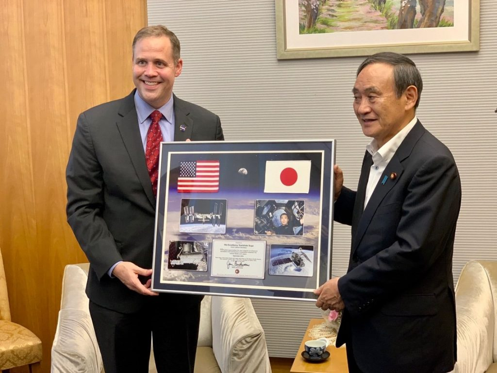 NASA Administrator Bridenstine presents a gift to Yoshihide Suga, chief cabinet secretary to the prime minister of Japan, on Sept. 25, 2019 at the Japanese prime minister's official residence in Tokyo.